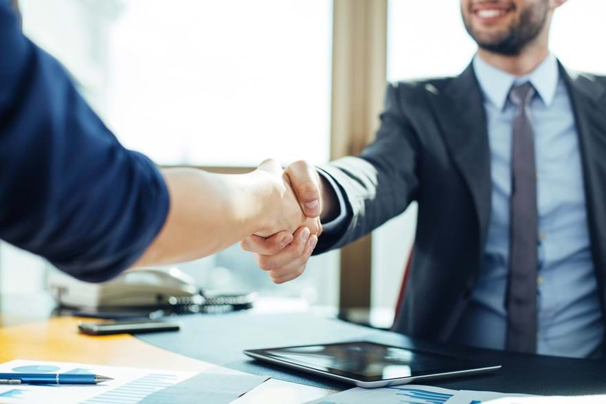 businessmen-shaking-hands-wfprhsrmanff